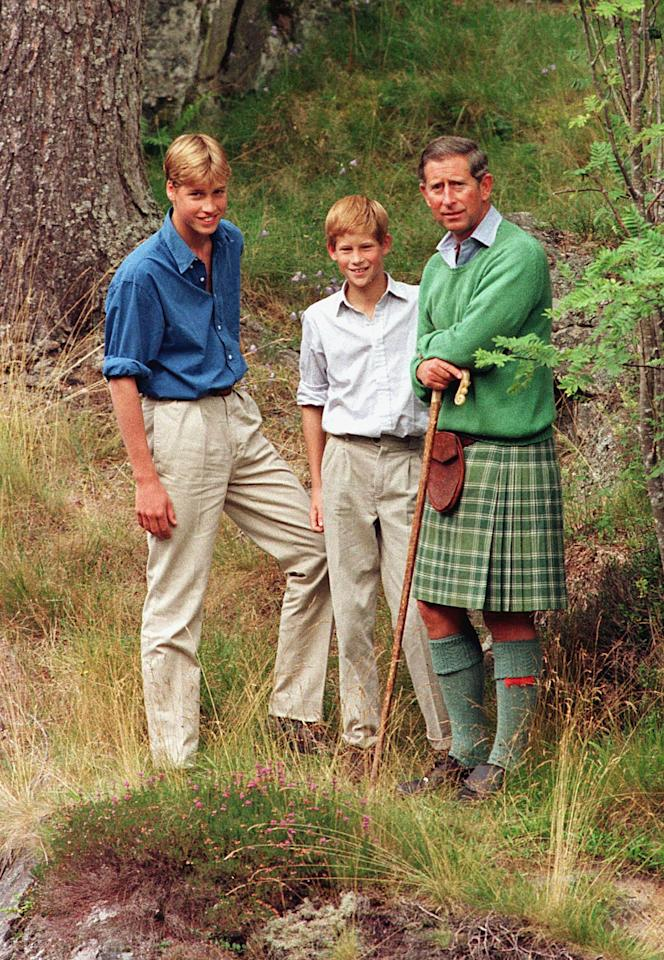 Prince Charles stands with his sons Princes William (L) and Harry on the banks of the river Muick near Ballater August 16. The group are currently enjoying a summer break at Balmoral Castle. Reuters/ Jeff J Mitchell UK