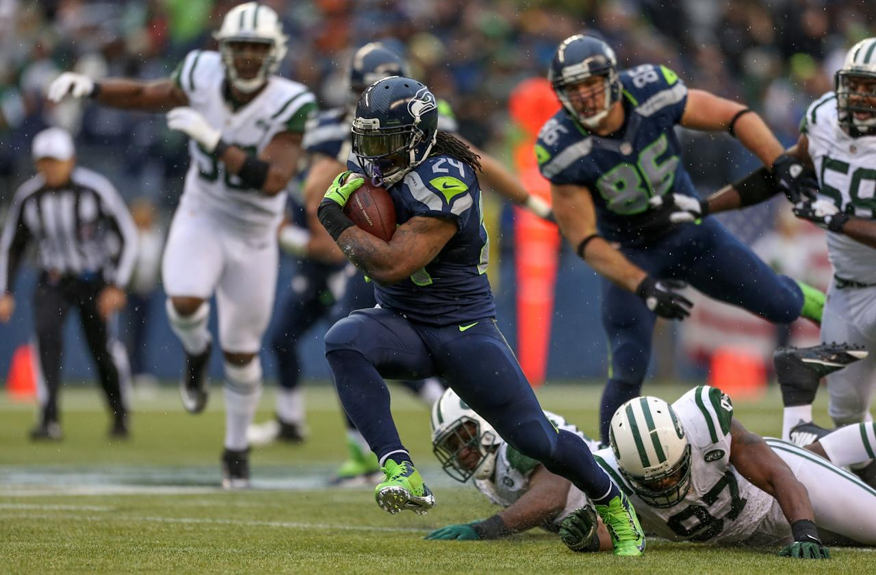SEATTLE, WA - NOVEMBER 11:  Running back Marshawn Lynch #24 of the Seattle Seahawks rushes against the New York Jets at CenturyLink Field on November 11, 2012 in Seattle, Washington. The Seahawks defeated the Jets 28-7.  (Photo by Otto Greule Jr/Getty Images)