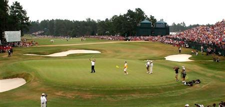 Campbell of New Zealand raises his putter after winning the 105th US Open in Pinehurst.