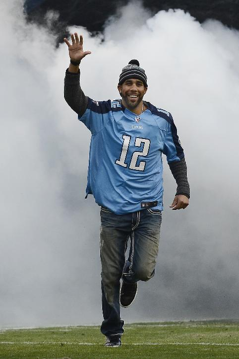 Tampa Rays pitcher David Price is introduced as the Tennessee Titans 12th Man before an NFL football game between the Titans and the Arizona Cardinals Sunday, Dec. 15, 2013, in Nashville, Tenn. Price played baseball for Vanderbilt University in Nashville. (AP Photo/Mark Zaleski)