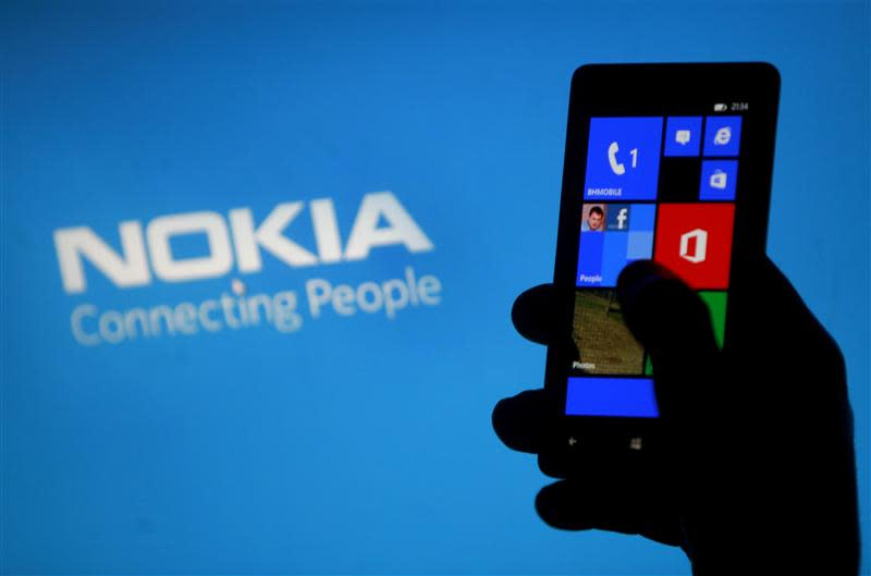 File illustration photo shows a woman posing with a Nokia Lumia smartphone in the central Bosnian town of Zenica