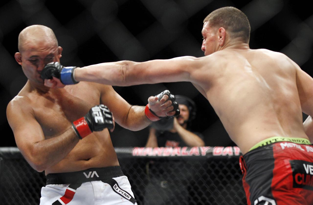 Nick Diaz, right, punches BJ Penn during a mixed martial arts welterweight bout, Saturday, Oct. 29, 2011, in Las Vegas. Diaz won by unanimous decision. (AP Photo/Isaac Brekken)