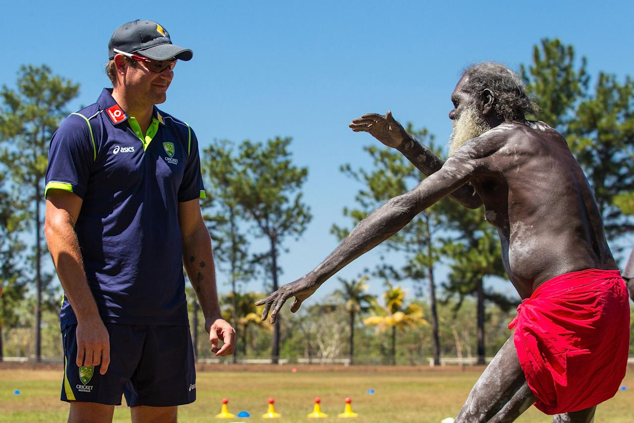 DARWIN, AUSTRALIA - AUGUST 10:  A tribal elder performs a welcome to land ceremony for Ryan Harris of the Australian cricket team during a visit to Pirlangimpi of the Tiwi Islands on August 10, 2012 on the Tiwi Islands, Australia.  (Photo by Mark Nolan/Getty Images)