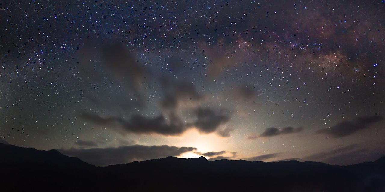 PIC BY ANTON JANKOVOY / CATERS NEWS - A starry-eyed photographer has captured the beauty of the Milky Way above the Himalayan night sky.Dedicated snapper, Anton Jankovoy, trekked up an adjacent mountainside to capture the perfect picture and even started meditating to overcome the freezing temperatures.Now the 23-year-old has caught a series of stunning shots, stopping in time the movement of the universe around the earth.One image shows the sprawling collection of stars, planets and solar systems hovering above the highest mountain range in the world.