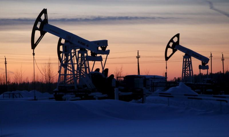 Oil drops amid caution over OPEC meeting; stocks mixed