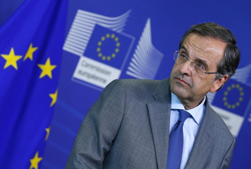Greece's Prime Minister Samaras attends a news conference after a meeting with European Commission President Barroso in Brussels