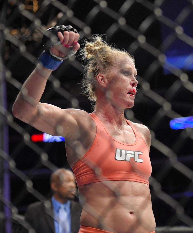 Holly Holm celebrates after defeating Raquel Pennington in a UFC 184 mixed martial arts bantamweight bout, Saturday, Feb. 28, 2015, in Los Angeles. (AP Photo/Mark J. Terrill)