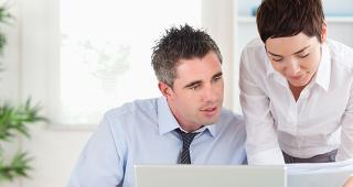 Man and woman working in the office copyright wavebreakmedia/Shutterstock.com