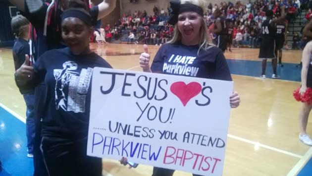 The Jesus Loves You sign that landed Patterson students in trouble — WAFB video screenshot