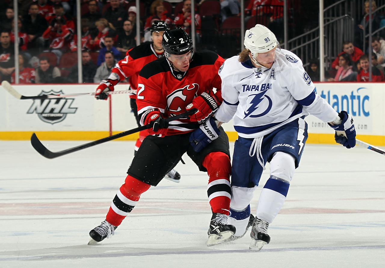 NEWARK, NJ - FEBRUARY 26:  Marek Zidlicky #2 of the New Jersey Devils checks Steven Stamkos #91 of the Tampa Bay Lightning at the Prudential Center on February 26, 2012 in Newark, New Jersey.  (Photo by Bruce Bennett/Getty Images)