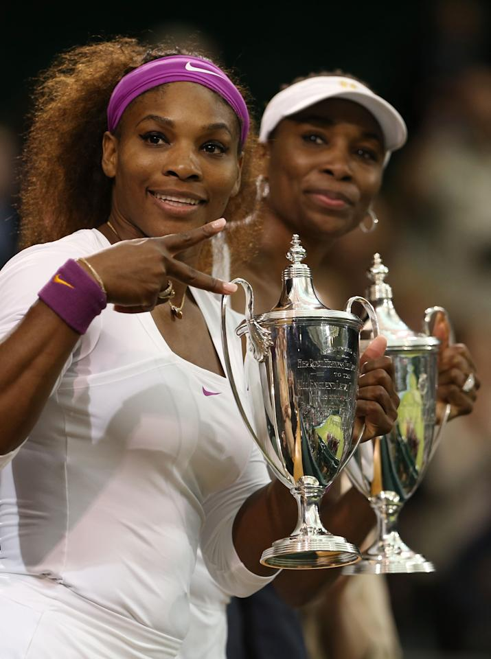 LONDON, ENGLAND - JULY 07:  Serena Williams (L) and Venus Williams of the USA celebrate with their winners trophies after their Ladies? Doubles final match against Andrea Hlavackova and Lucie Hradecka of the Czech Republic on day twelve of the Wimbledon Lawn Tennis Championships at the All England Lawn Tennis and Croquet Club on July 7, 2012 in London, England.  (Photo by Julian Finney/Getty Images)