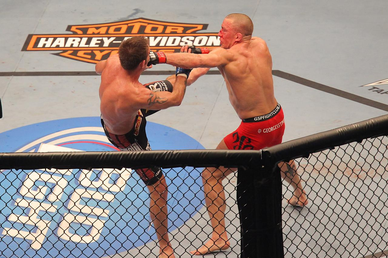 TORONTO, ON - APRIL 30: Georges St-Pierre (R) hits Jake Shields during their Welterweight Championship bout at UFC 129 in the Rogers Centre on April 30, 2011 in Toronto, Ontario. (Photo by Tom Szczerbowski/Zuffa LLC/Zuffa LLC via Getty Images)