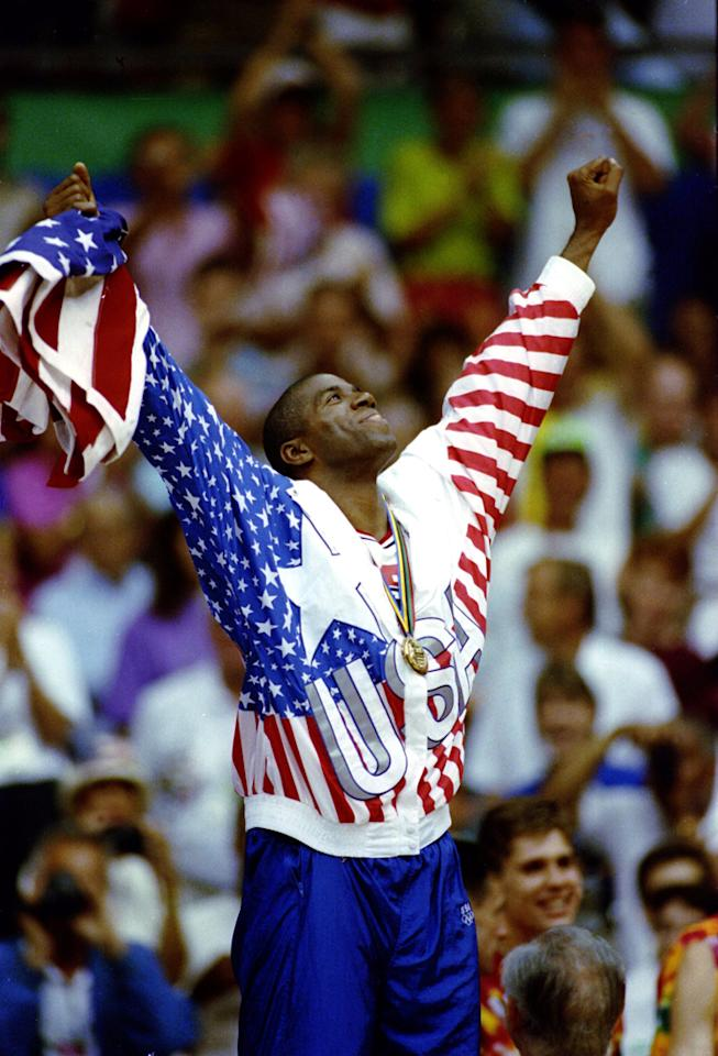 "Magic Johnson of the United States celebrates after receiving his gold medal on the 1st place podium during the 1992 Barcelona Olympics in Barcelona, Spain.<br><br><b>Also on Shine:</b><br><a href=""http://shine.yahoo.com/author-blog-posts/team-mom-pep-talk-kristi-yamaguchi-lessons-lifelong-132800152.html"">Team Mom Pep Talk with Kristi Yamaguchi: Lessons from a Lifelong Athlete</a><br><a href=""http://shine.yahoo.com/team-mom/study-pee-wee-pop-warner-football-players-nfl-220600310.html;_ylt=An.8Bppjyq5hfVSqS4pA7jNWkqU5;_ylu=X3oDMTF1ams3Y3RuBG1pdANDeFMgUFNPTSBIdWIgQmxvZyBQb3N0cyBQcm9kBHBvcwMxMwRzZWMDTWVkaWFCbG9nSW5kZXhUZW1w;_ylg=X3oDMTFrM25vcXFyBGludGwDdXMEbGFuZwNlbi11cwRwc3RhaWQDBHBzdGNhdAMEcHQDc2VjdGlvbnMEdGVzdAM-;_ylv=3"">Study: Pee Wee and Pop Warner Football Players Take NFL-Like Hits</a><br><a href=""http://shine.yahoo.com/team-mom/10-ways-cheer-kids-without-being-annoying-embarrassing-181600750.html"">10 Ways to Cheer on Your Kids Without Being Annoying and Embarrassing</a>"