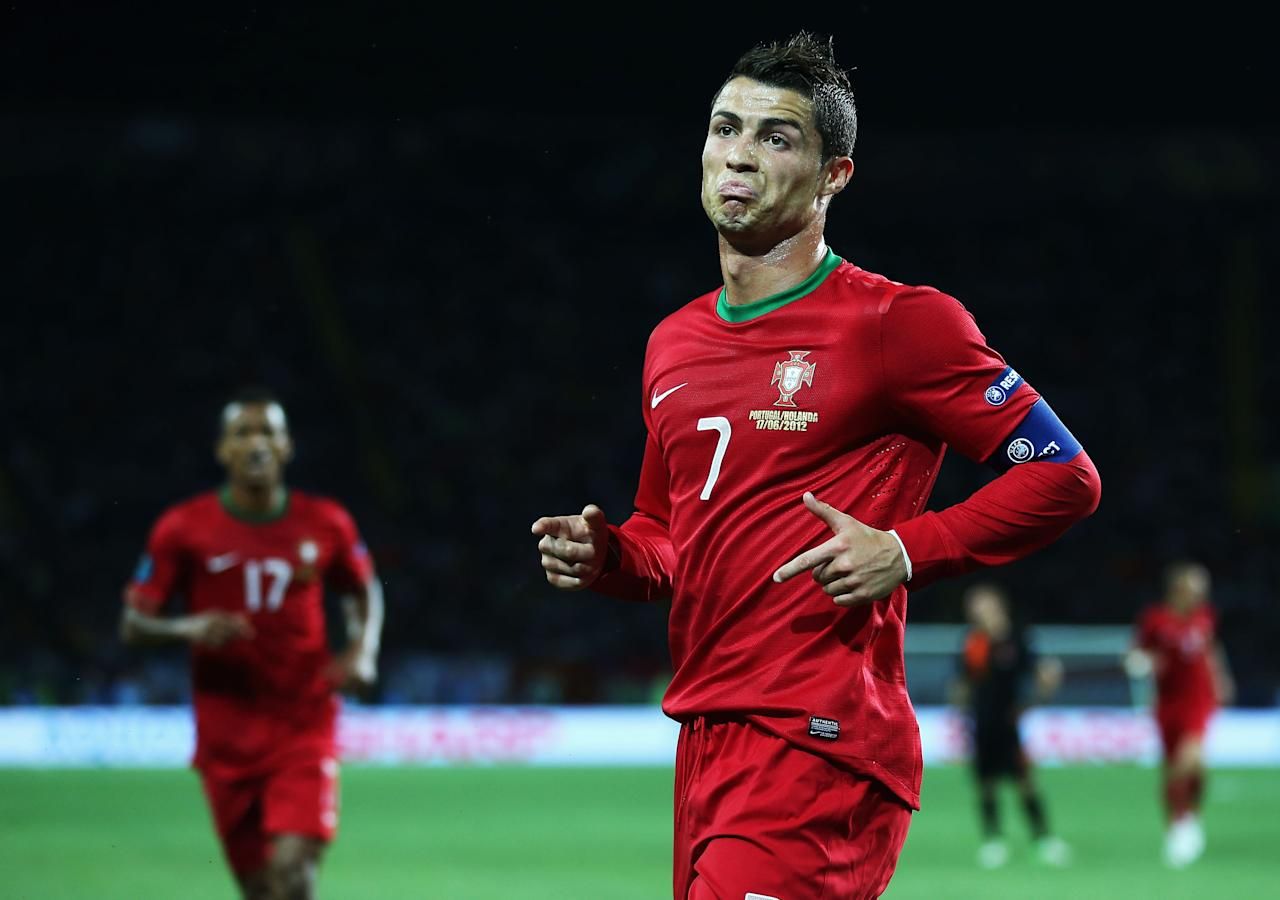 KHARKOV, UKRAINE - JUNE 17:  Cristiano Ronaldo of Portugal celebrates scoring his team's first goal during the UEFA EURO 2012 group B match between Portugal and Netherlands at Metalist Stadium on June 17, 2012 in Kharkov, Ukraine.  (Photo by Julian Finney/Getty Images)