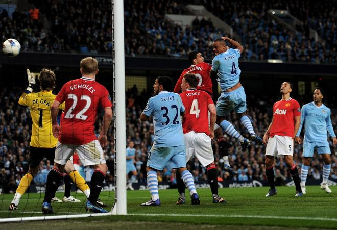 MANCHESTER, ENGLAND - APRIL 30:  Vincent Kompany of Manchester City scores the opening goal during the Barclays Premier League match between Manchester City and Manchester United at the Etihad Stadium on April 30, 2012 in Manchester, England. (Photo by Michael Regan/Getty Images)