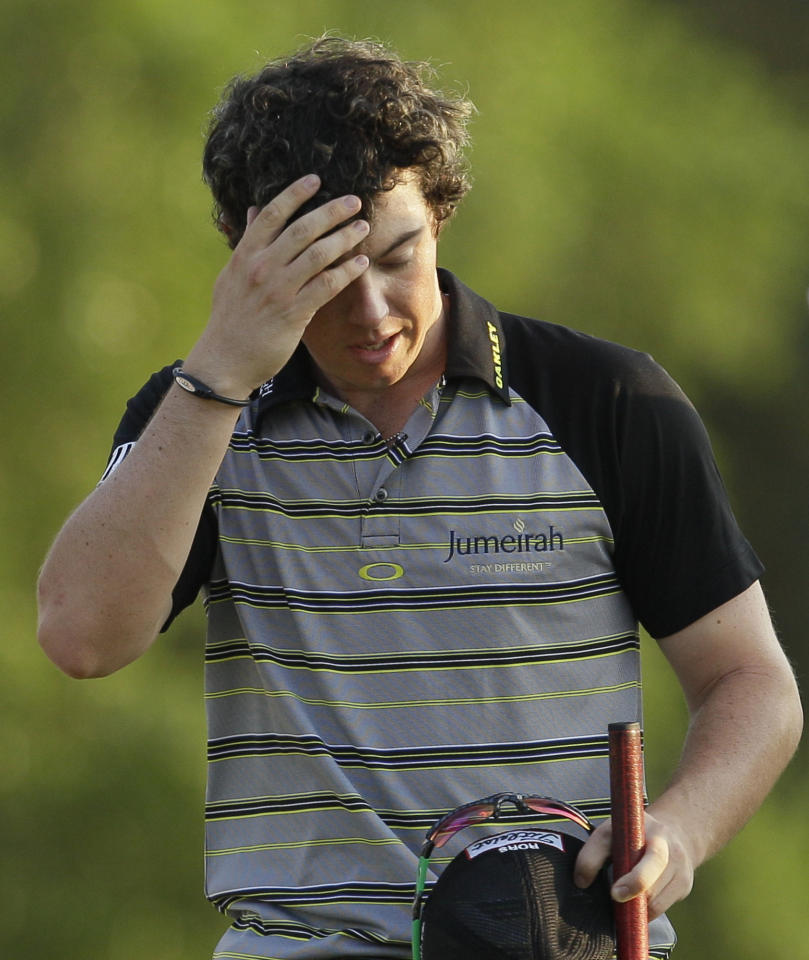 FILE - This April 10, 2011, file photo shows Rory McIlroy wiping his forehead after his final round of the Masters golf tournament, in Augusta, Ga. (AP Photo/David J. Phillip, File)