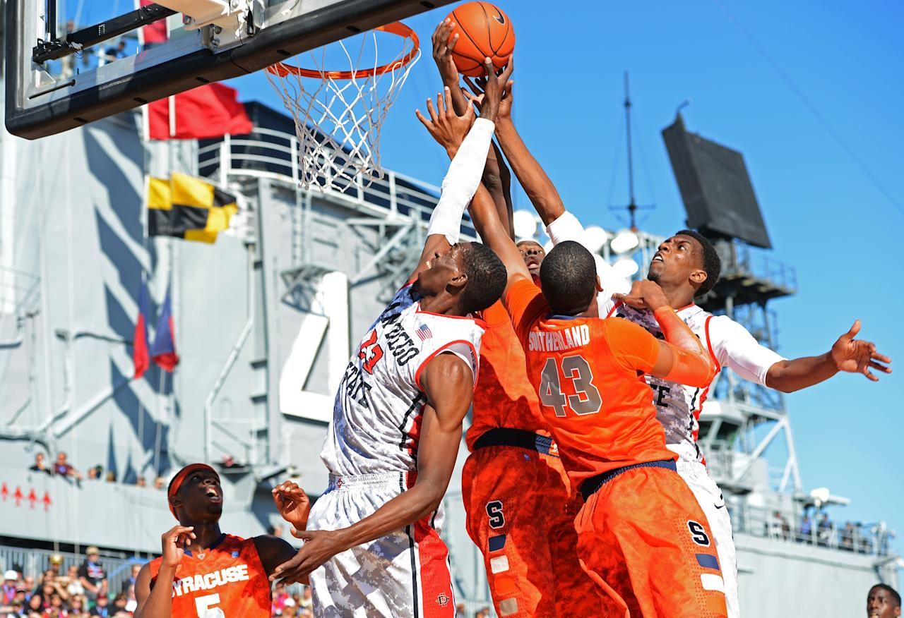 SAN DIEGO, CA - NOVEMBER 11:  James Southerland #43 of the Syracuse Orange vies for a rebound with Deshawn Stephens #23 and Winston Shepard #13 of the San Diego State Aztecs during the Battle On The Midway on board the USS Midway Aircraft Carrier on November 11, 2012 in San Diego, California.  (Photo by Harry How/Getty Images)