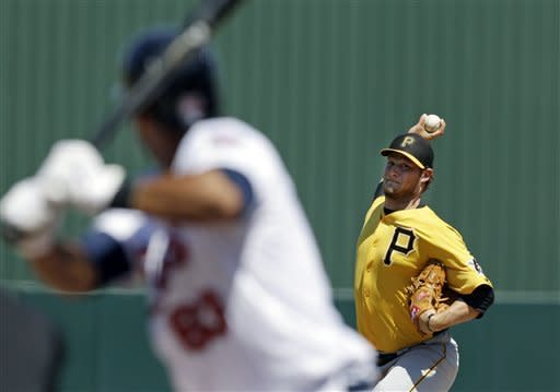 Pittsburgh Pirates starting pitcher Gerrit Cole delivers to Minnesota Twins' Aaron Hicks during the first inning of an exhibition spring training baseball game in Fort Myers, Fla., Saturday, March 16, 2013. (AP Photo/Elise Amendola)