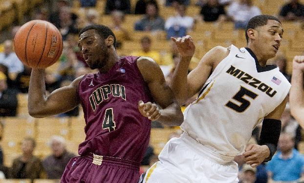 Missouri's Jordan Clarkson, right, fouls IUPUI's Ian Chiles as they vie for a rebound during the second half of an NCAA college basketball game Monday, Nov. 25, 2013, in Columbia, Mo. Missouri won 78-64