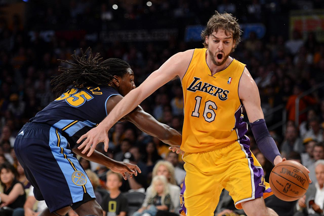 LOS ANGELES, CA - MAY 12:  Pau Gasol #16 of the Los Angeles Lakers drives on Kenneth Faried #35 of the Denver Nuggets in the first quarter in Game Seven of the Western Conference Quarterfinals in the 2012 NBA Playoffs on May 12, 2012 at Staples Center in Los Angeles, California. NOTE TO USER: User expressly acknowledges and agrees that, by downloading and or using this photograph, User is consenting to the terms and conditions of the Getty Images License Agreement.  (Photo by Harry How/Getty Images)
