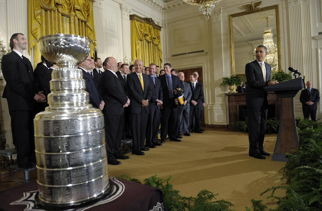 President Barack Obama honors the 2010-2011Stanley Cup champion Boston Bruins hockey team, Monday, Jan. 23, 2012, in the East Room of the White House in Washington. (AP Photo/Susan Walsh)