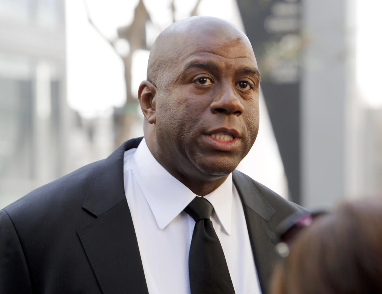 "Former Los Angeles Lakers player Earvin ""Magic"" Johnson arrives at a memorial service for Jerry Buss, whose Lakers won 10 NBA basketball championships under his ownership, Thursday, Feb. 21, 2013 in Los Angeles. Buss died on Monday. He was 80. (AP Photo/Reed Saxon)"