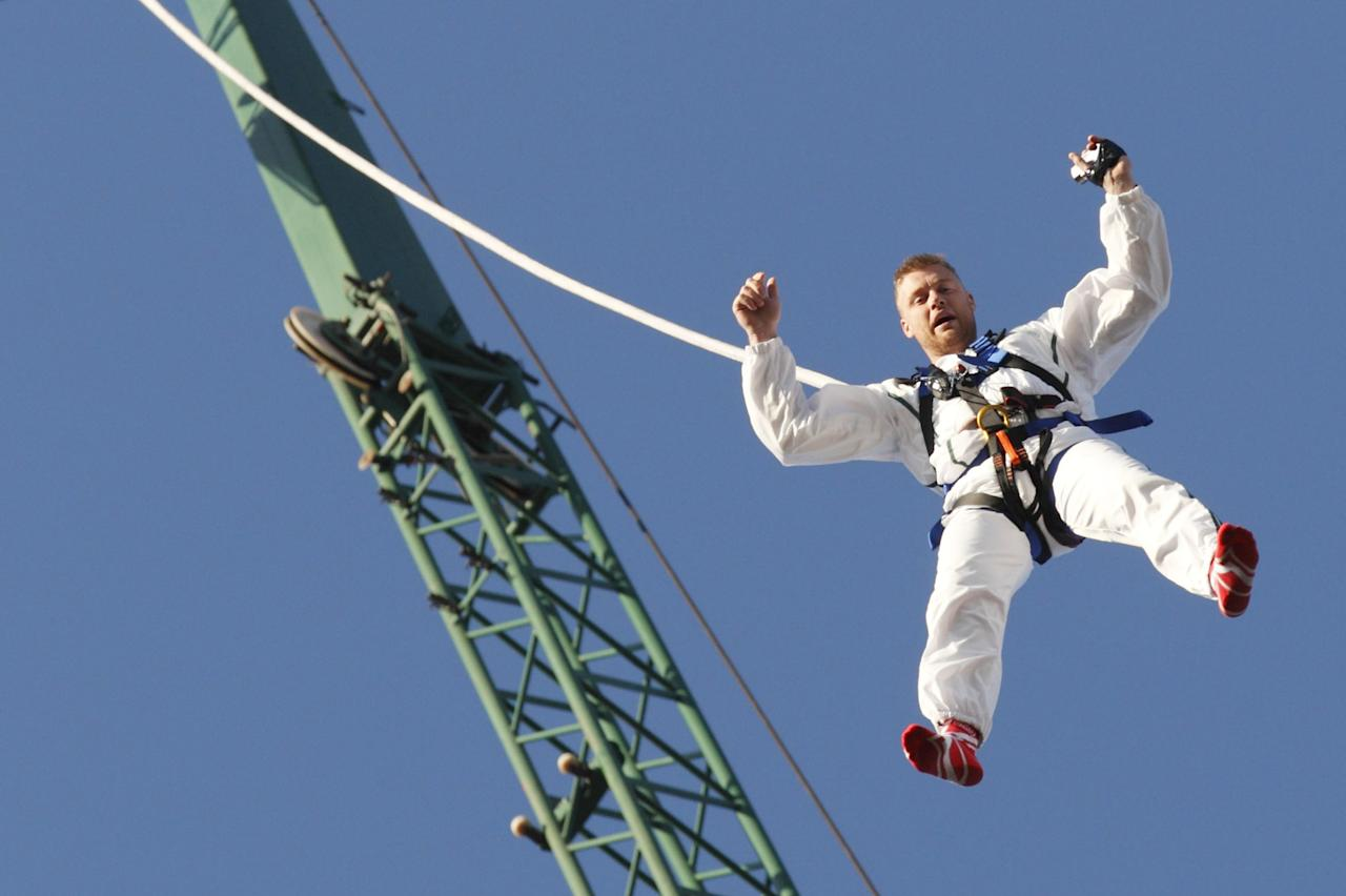 "Former England cricketer Andrew ""Freddie"" Flintoff dangles from a rope as he attempts to break the world record for the highest reverse bungee jump in North London on March 19, 2012. Flintoff was attempting to set twelve Guinness World Records in 12 hours to raise money for the Sport Relief charity. AFP PHOTO / JUSTIN TALLIS (Photo credit should read JUSTIN TALLIS/AFP/Getty Images)"