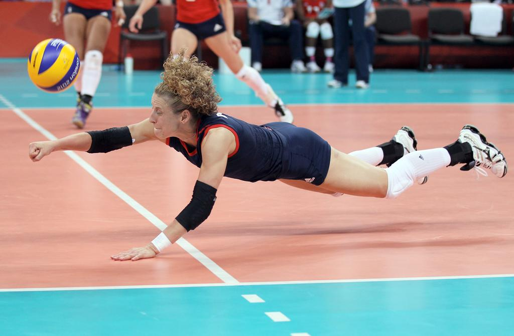 Maria Bertelli #7 of Great Britain dives for the ball in the third set against Russia during Women's Volleyball on Day 1 of the London 2012 Olympic Games at Earls Court on July 28, 2012 in London, England.  (Photo by Elsa/Getty Images)