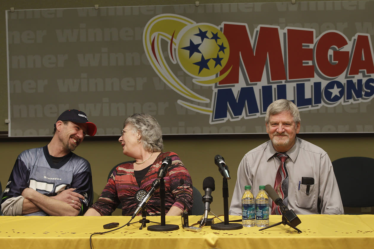 <b>$190 million</b><br><br>Jim and Carolyn McCullar, of Ephrata, Wash., <br>the winners of a $190 million Mega Millions lottery jackpot, talk to reporters as their son Jason McCullar looks on at left, Thursday, Jan. 6, 2011, in Olympia, Wash.