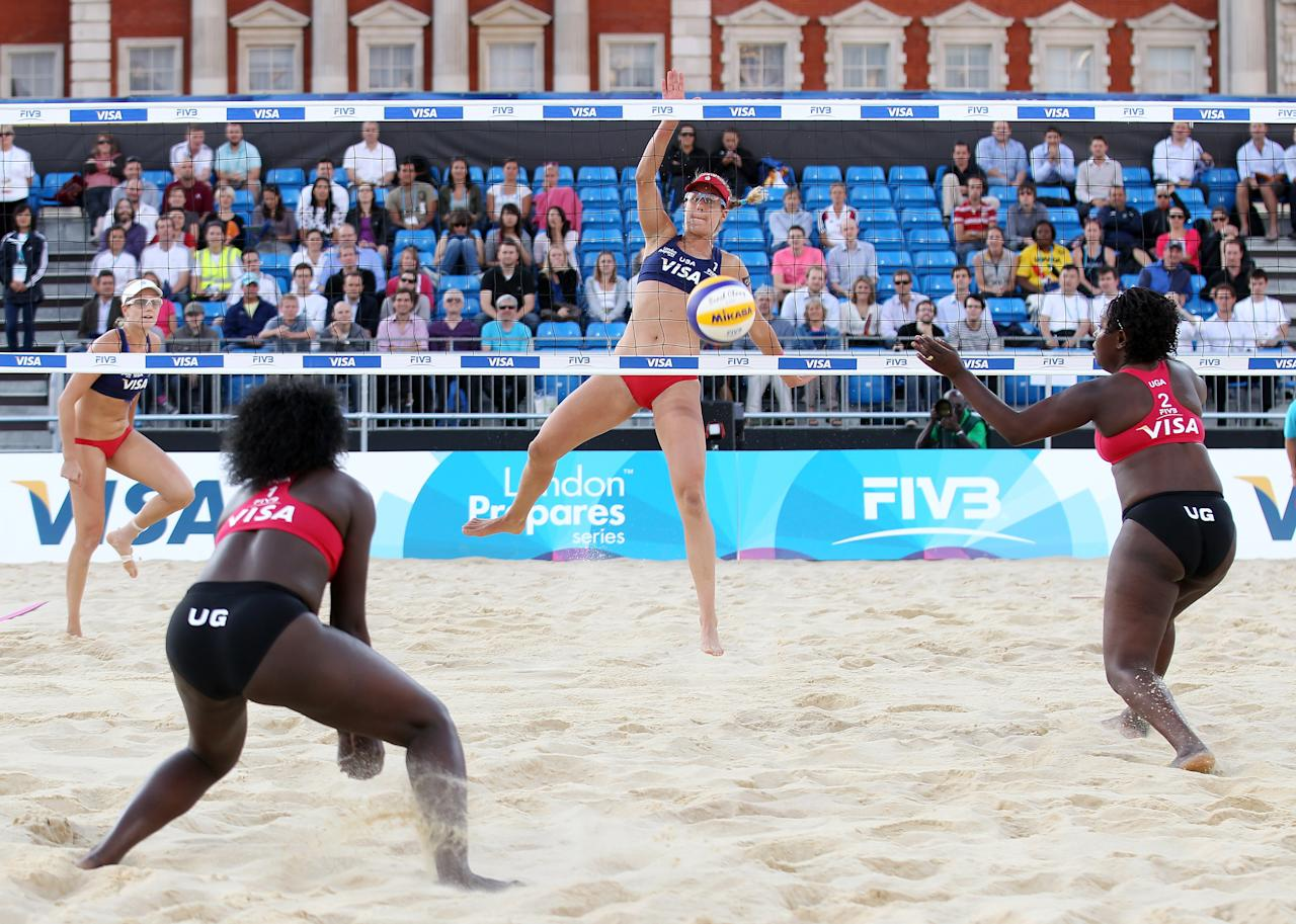 LONDON, ENGLAND - AUGUST 09:  April Ross of the USA smashes a shot past the team from Uganda during the VISA FIVB Beach Volleyball International at Horse Guards Parade on August 9, 2011 in London, England.  (Photo by Scott Heavey/Getty Images)