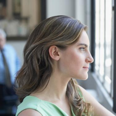 Side-profile-of-a-businesswoman-looking-through-a-window_web