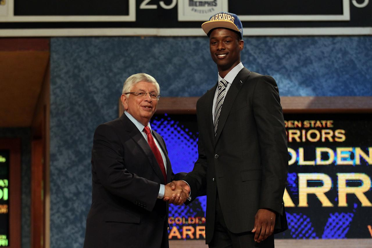 NEWARK, NJ - JUNE 28:  Harrison Barnes (R) of North Carolina greets NBA Commissioner David Stern (L) after he was selected number seven overall by the Golden State Warriors during the first round of the 2012 NBA Draft at Prudential Center on June 28, 2012 in Newark, New Jersey. NOTE TO USER: User expressly acknowledges and agrees that, by downloading and/or using this Photograph, user is consenting to the terms and conditions of the Getty Images License Agreement.  (Photo by Elsa/Getty Images)