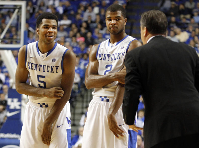 Aaron and Andrew Harrison staying at Kentucky