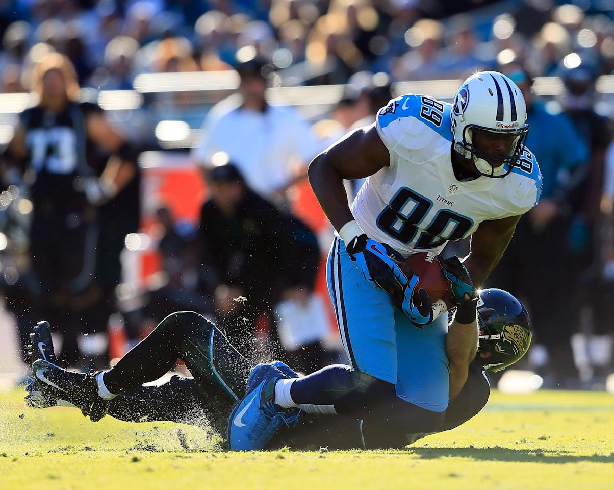 JACKSONVILLE, FL - NOVEMBER 25:  Chris Prosinski #42 of the Jacksonville Jaguars attempts to tackle  Jared Cook #89 of the Tennessee Titans during the game at EverBank Field on November 25, 2012 in Jacksonville, Florida.  (Photo by Sam Greenwood/Getty Images)