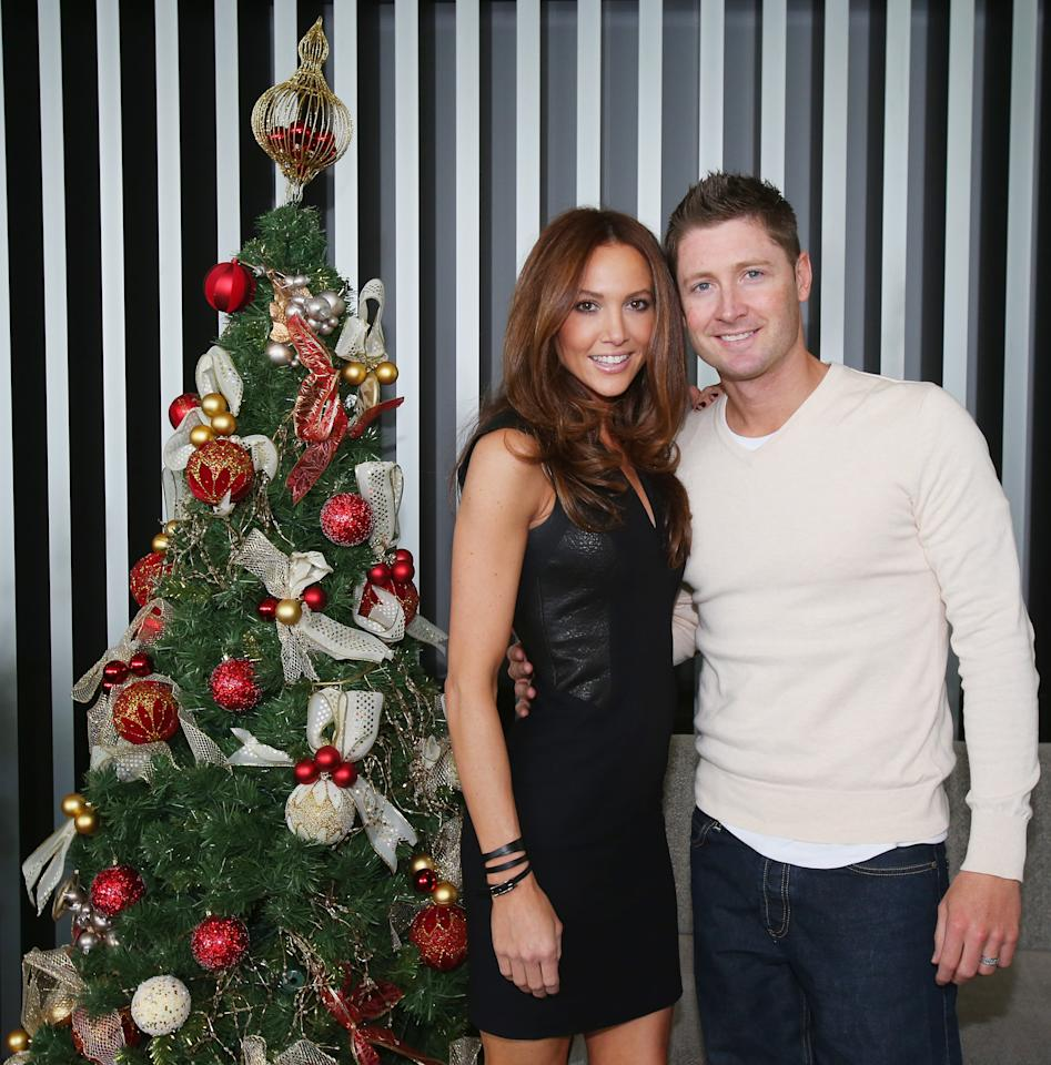 MELBOURNE, AUSTRALIA - DECEMBER 25:  Michael Clarke of Australia and his wife Kyly Clarke pose next to a Christmas tree ahead of a Cricket Australia Christmas Day lunch at Crown Entertainment Complex on December 25, 2012 in Melbourne, Australia.  (Photo by Scott Barbour/Getty Images)