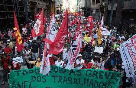Members of the Roofless Movement join metro workers in a protest on the fifth day of a strike in Sao Paulo