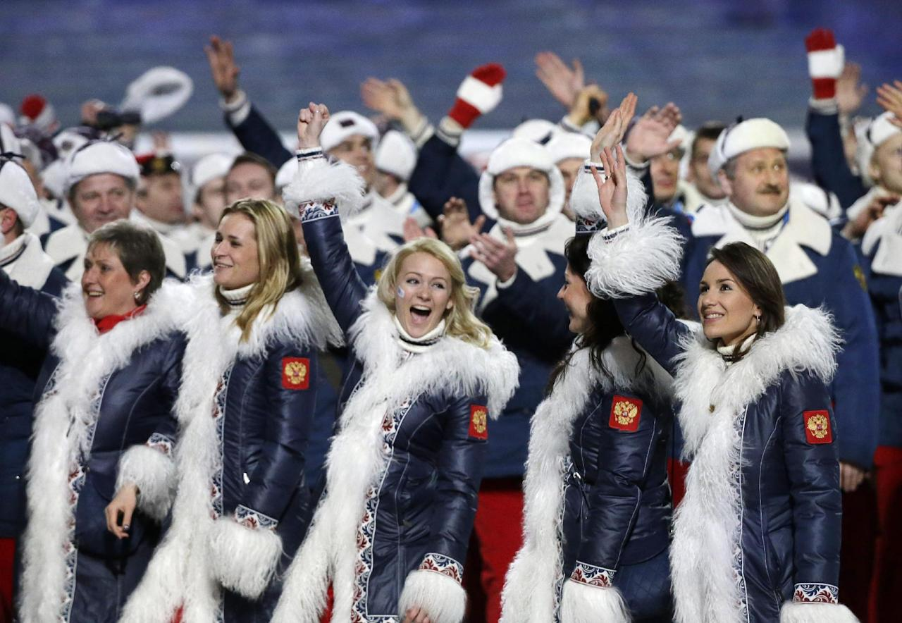 Russian athletes wave to spectators as they arrive during the opening ceremony of the 2014 Winter Olympics in Sochi, Russia, Friday, Feb. 7, 2014. (AP Photo/Mark Humphrey)