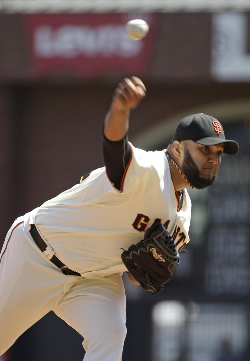 Record-setting Petit leads Giants past Rockies 4-1