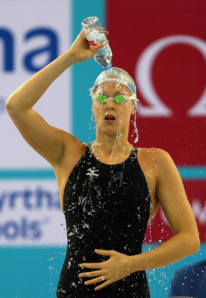 DUBAI, UNITED ARAB EMIRATES - DECEMBER 19:  Federica Pellegrini of Italy prepares for the Women's 200m Freestyle final on day five of the 10th FINA World Swimming Championships (25m) at the Hamdan bin Mohammed bin Rashid Sports Complex on December 19, 2010 in Dubai, United Arab Emirates.  (Photo by Clive Rose/Getty Images)