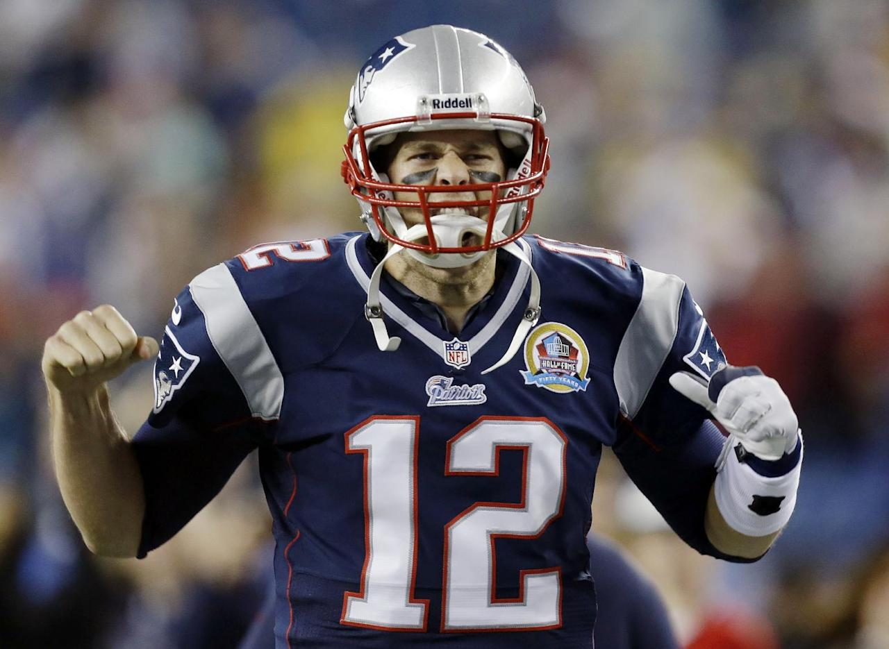 New England Patriots quarterback Tom Brady reacts as he runs onto the field before an NFL football game against the Houston Texans in Foxborough, Mass., Monday, Dec. 10, 2012. (AP Photo/Elise Amendola)
