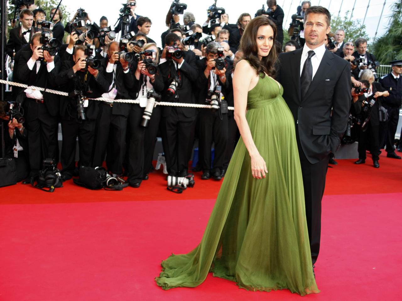 """Voice actress Angelina Jolie and actor Brad Pitt arrive for the screening of the animated film """"Kung Fu Panda"""" by directors Mark Osborne and John Stevenson at the 61st Cannes Film Festival May 15, 2008.    REUTERS/Eric Gaillard  (FRANCE)"""