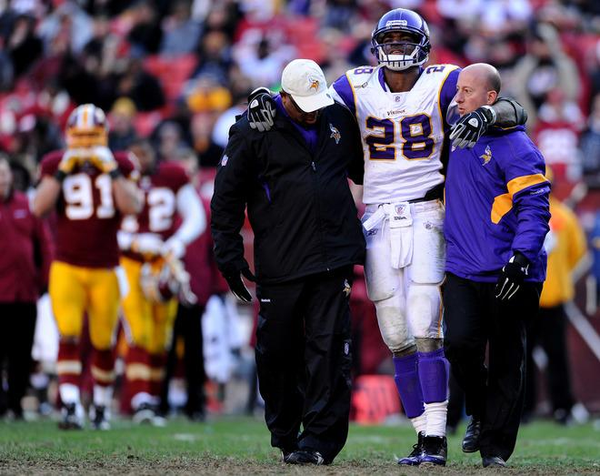 LANDOVER, MD - DECEMBER 24: Running back Adrian Peterson #28 of the Minnesota Vikings is helped off the field after being injured in the third quarter against the Washington Redskins at FedEx Field on December 24, 2011 in Landover, Maryland. (Photo by Patrick Smith/Getty Images)