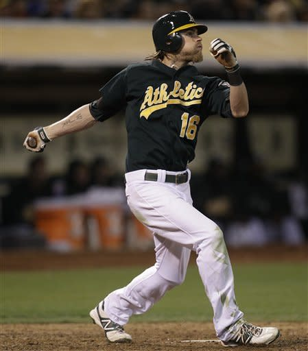 A's roll past Red Sox 7-1, lose Inge to injury