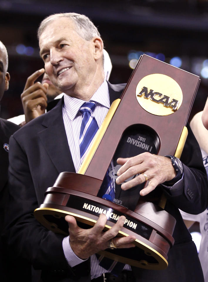 Connecticut Huskies head coach Jim Calhoun holds the NCAA trophy after the Huskies defeated the Butler Bulldogs in their men's final NCAA Final Four College Championship basketball game in Houston, Texas, April 4, 2011. REUTERS/Lucy Nicholson (UNITED STATES - Tags: SPORT BASKETBALL)