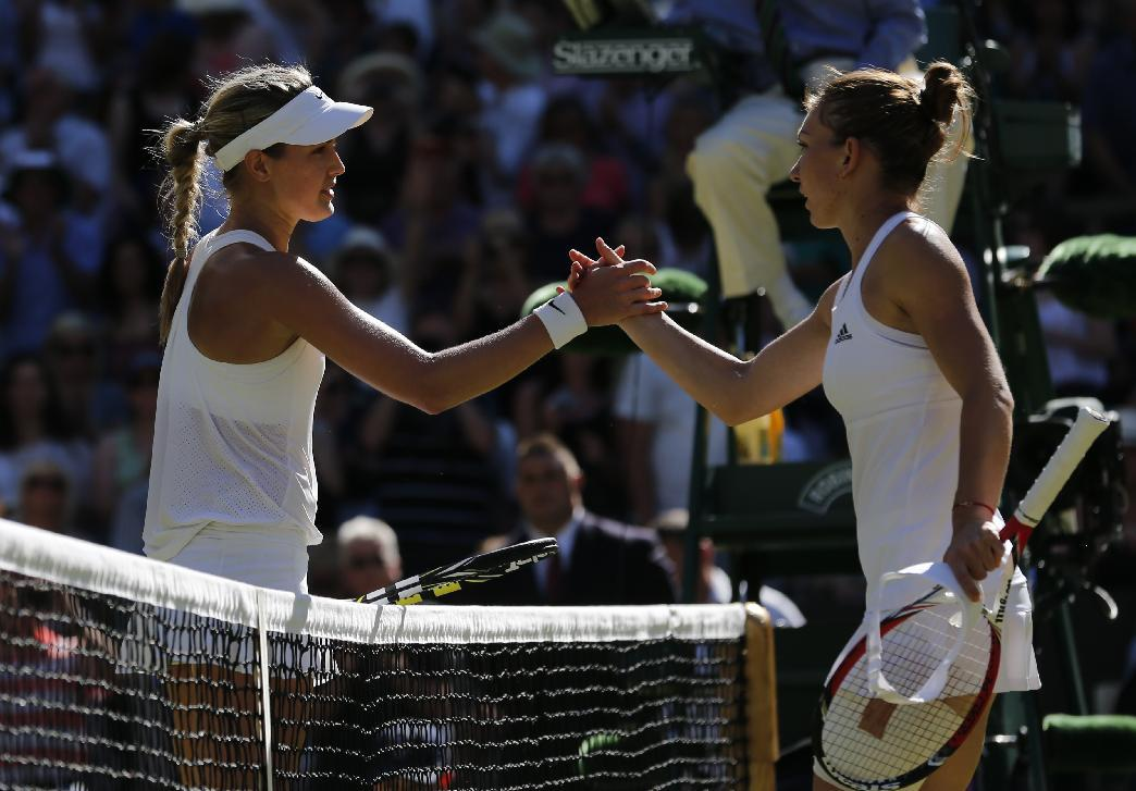 Eugenie Bouchard of Canada shakes hands after defeating Simona Halep of Romania, right, in the women's singles semifinal match at the All England Lawn Tennis Championships in Wimbledon, London, Thursday July 3, 2014. (AP Photo/Ben Curtis)