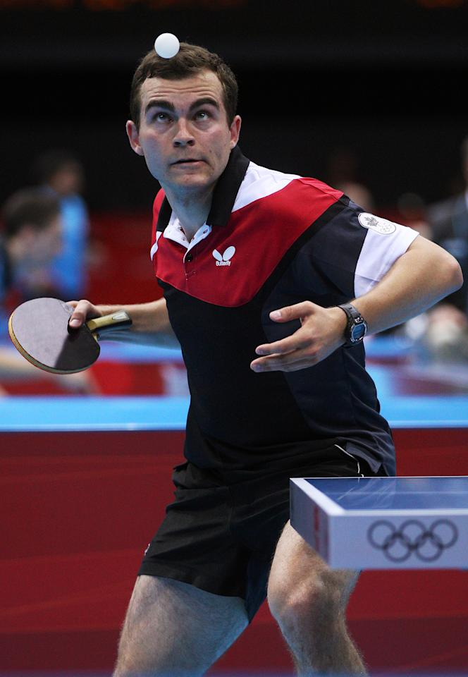 LONDON, ENGLAND - JULY 28:  Pierre-Luc Hinse of Canada serves against Matiss Burgis of Latvia during their Men's Singles Table Tennis match on Day 1 of the London 2012 Olympic Games at ExCeL on July 28, 2012 in London, England.  (Photo by Feng Li/Getty Images)
