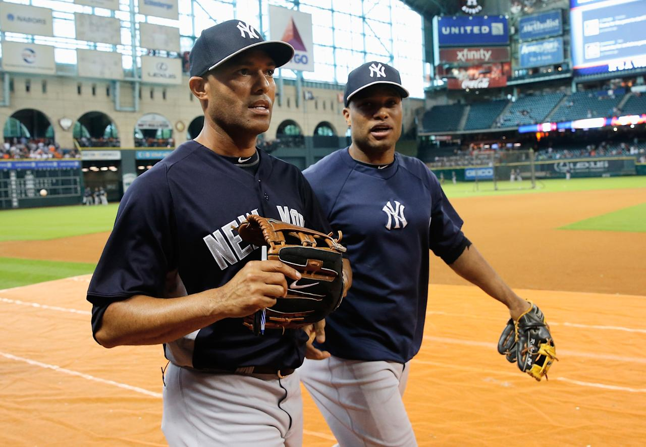 HOUSTON, TX - SEPTEMBER 28: Mariano Rivera #42 and Robinson Cano #24 of the New York Yankees walk on the field before the game against the Houston Astros at Minute Maid Park on September 28, 2013 in Houston, Texas. (Photo by Scott Halleran/Getty Images)
