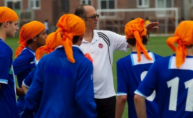 The FC Brossard team practices while wearing turbans in support of banned Sikh peers — Canadian Press/Montreal Gazette