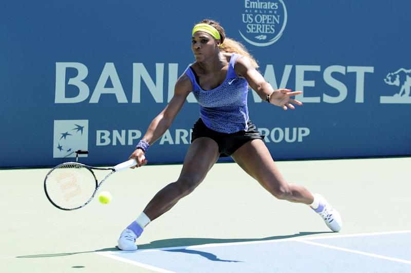 Serena Williams hits a low shot against Andrea Petkovic during the Bank of the West Classic at the Taube Family Tennis Stadiumon August 2, 2014 in Stanford, California