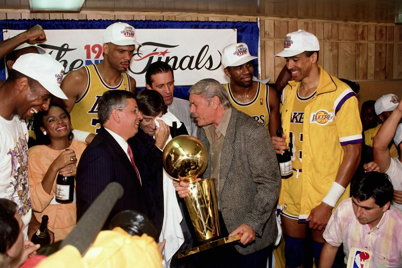 <p>LOS ANGELES - JUNE 14: Los Angeles Lakers Owner Jerry Buss and the Los Angeles Lakers celebrate in the locker room after winning the 1987 NBA Finals against the Boston Celtics on June 14, 1987 in Los Angeles, California. Lakers 106 vs Celtics 93. NOTE TO USER: User expressly acknowledges and agrees that, by downloading and/or using this Photograph, user is consenting to the terms and conditions of the Getty Images License Agreement. Mandatory Copyright Notice: Copyright 1987 NBAE (Photo by Andrew D. Bernstein/NBAE via Getty Images)</p>